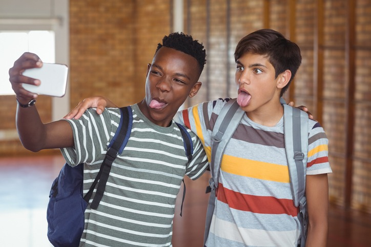 Image of teen boys posing for a selfie