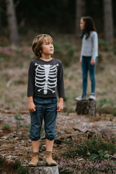 Image of a 10 Year Old Boy Standing outside wearing a shirt with a rib cage skeleton on it