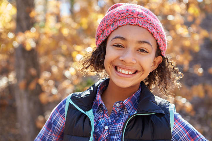Image of a 11 Year Old Girl Outside Smiling