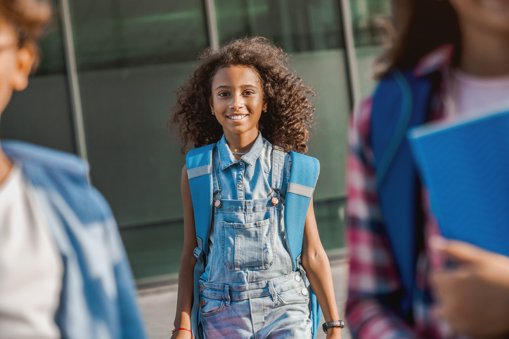 image of a 12 year old girl with a backpack