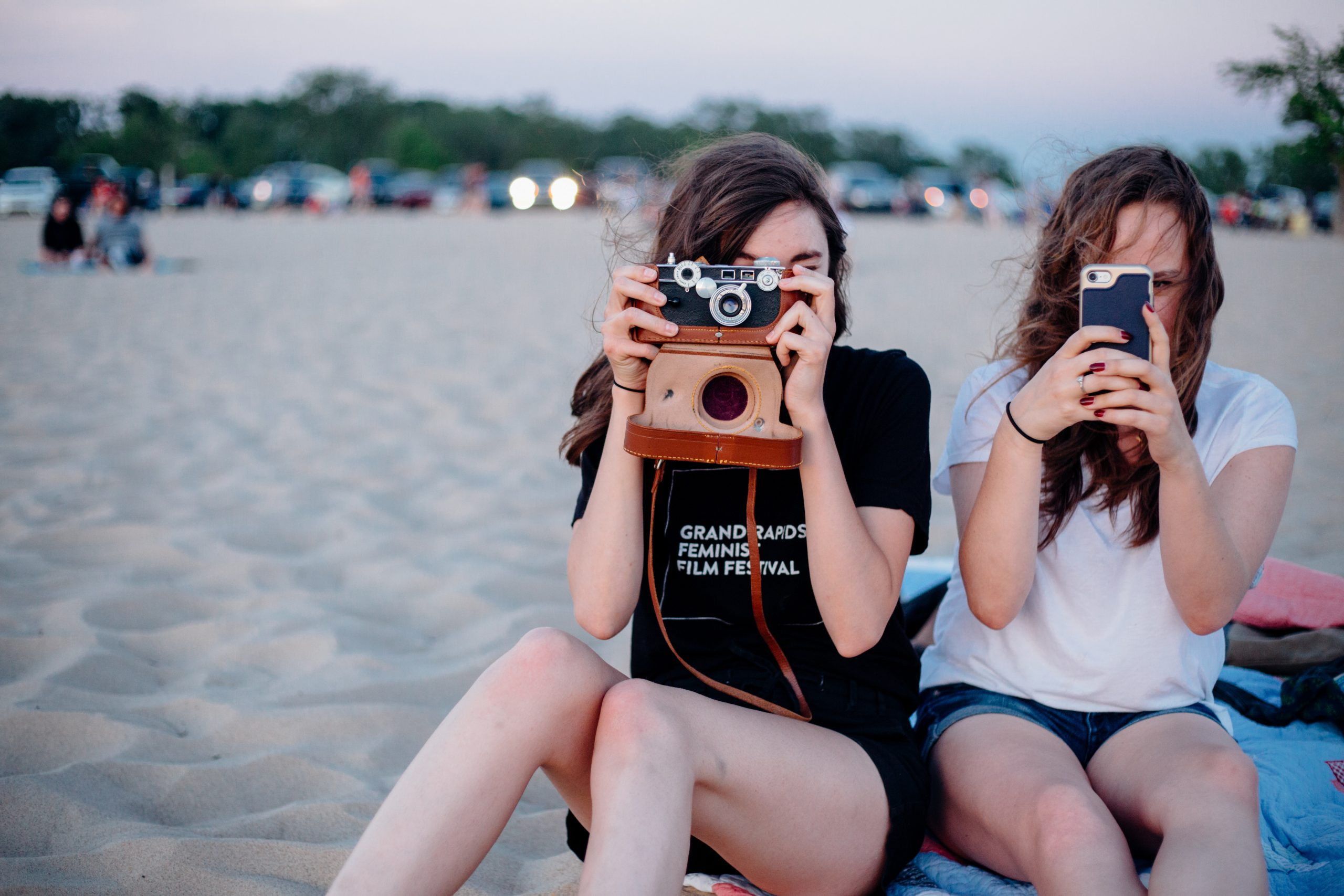image of 18 year old girls using their cameras to take a picutre