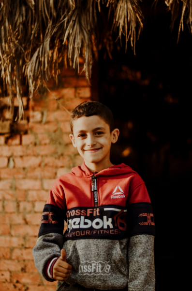 Image of a 9 Year Old Boy Smiling for the camera