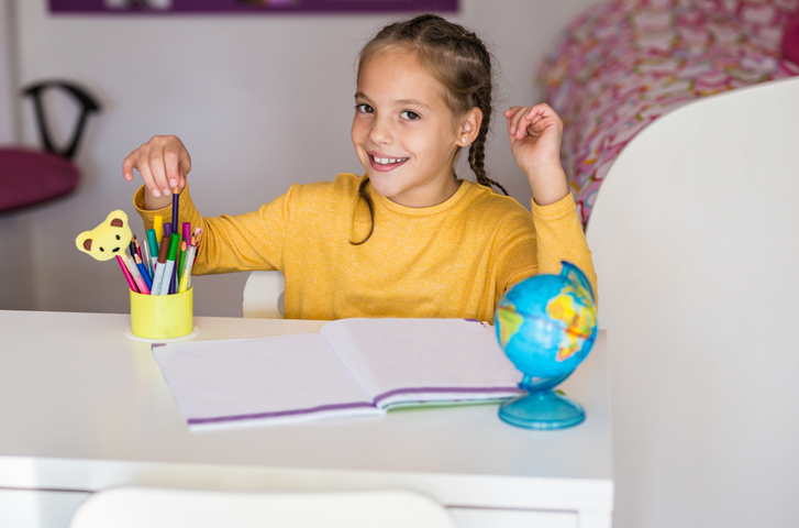 Image of a 9 Year Old Girl Studying At A Desk
